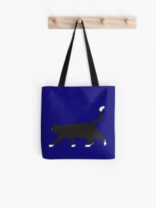 black cat in the blue night tote bag