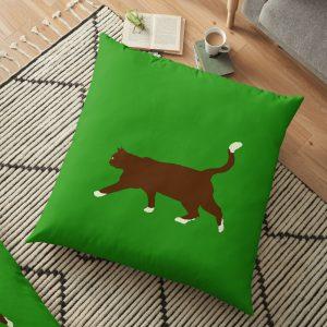 Tomcat exploring floor pillow by Susan Wilander